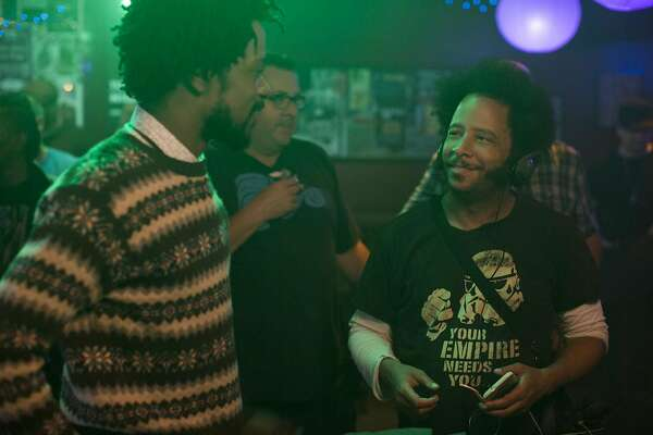 """Boots Riley (right) directs Lakeith Stanfield (left) in a scene from Riley's debut feature, """"Sorry to Bother You."""" Photo by Peter Prato, courtesy of Annapurna Pictures. (l to r.) Lakeith Stanfield and director Boots Riley on the set of SORRY TO BOTHER YOU, an Annapurna Pictures release."""