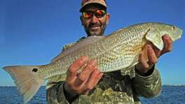 Displaying a 22-inch redfish, guide Capt. Kyle Lafreniere, who lost everything in Hurricane Harvey, is back in business.