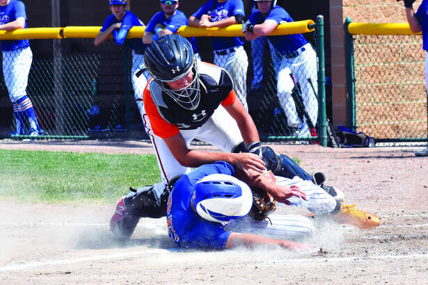 Edwardsville catcher Weston Slemmer, top, tags out the Rawlings Xtreme 18 runner at the plate during the first inning of Thursday's game at Tom Pile Field in Edwardsville.