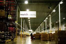 A worker inside the Wayfair distribution center in Cranbury, N.J., April 13, 2017. Internet retailers can be required to collect sales taxes in states where they have no physical presence, the Supreme Court ruled on June 21, 2018. State officials in South Dakota sued three online retailers, including Wayfair, for violating a law that required merchants to collect sales tax.