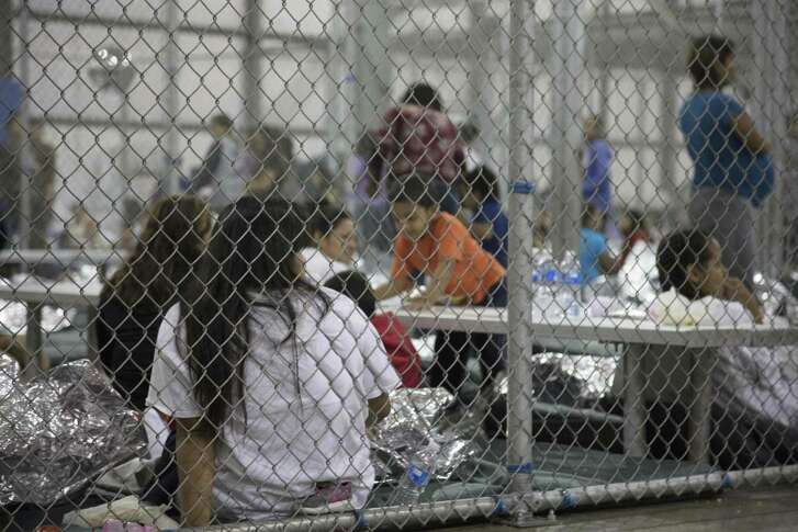This U.S. Customs and Border Protection photo dated June 17 and obtained June 18 shows intake of illegal border crossers by the Border Patrol at the Central Processing Center in McAllen, Texas. Children have been taken away from their mothers and fathers in the Border Patrol's South Texas Rio Grande Valley sector. Readers debate the practice, which Trump is rescinding.