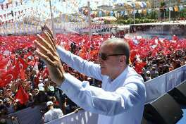 Turkey's President and ruling Justice and Development Party leader Recep Tayyip Erdogan addresses supporters during an election rally in Sanliurfa, Turkey, June 20. Trump's seeming embrace of dictators give a green light for leaders such as Erdogan to clamp down on dissent.