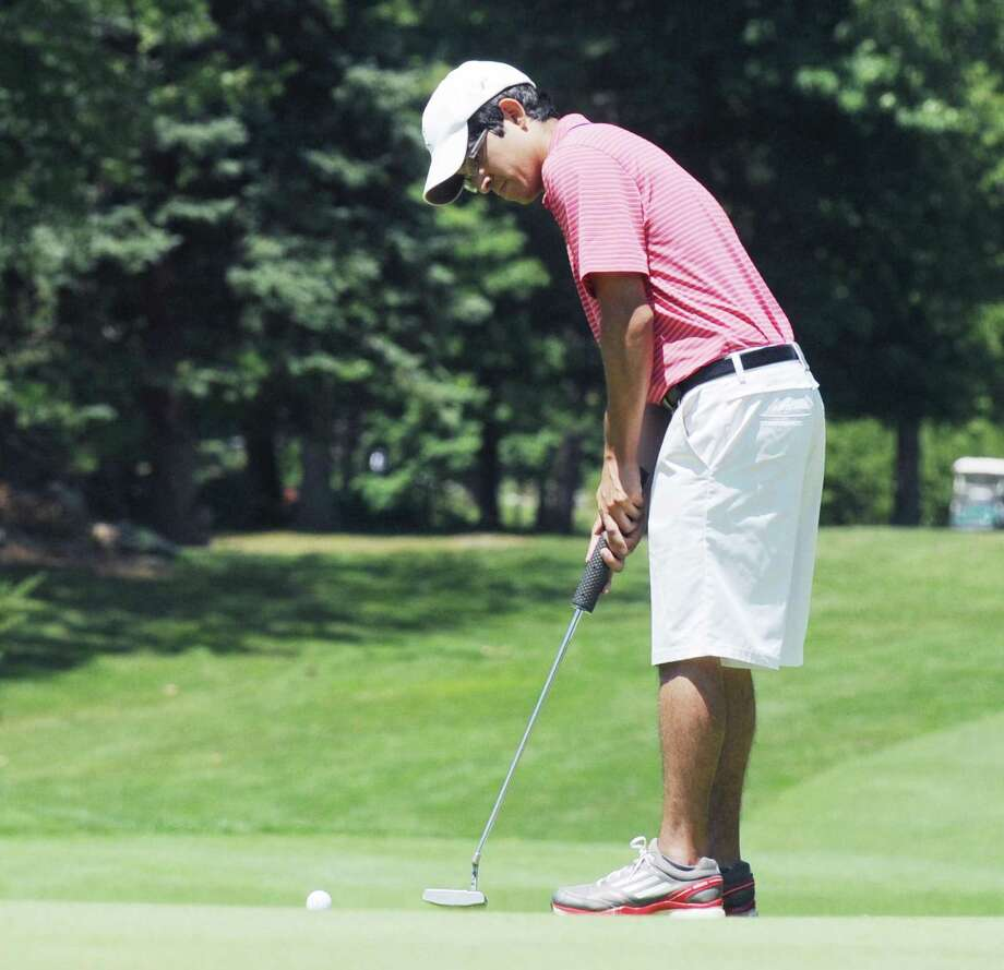 Jason Morilla putts on the second green during the Greenwich Men's Town Golf Tournament at the Griffith E. Harris Golf Course in Greenwich on June 25, 2017. Photo: Bob Luckey Jr. / Hearst Connecticut Media / Greenwich Time