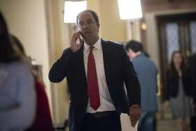 Rep. Will Hurd, R-Texas, whose congressional district runs along the majority of the border with Mexico, leaves the House chamber following a vote on an immigration bill crafted by GOP conservatives, at the Capitol in Washington, Thursday, June 21, 2018. The bill was defeated and Republican leaders delayed a planned vote on a compromise GOP package with the party's lawmakers fiercely divided over an issue that has long confounded the party. (AP Photo/J. Scott Applewhite)