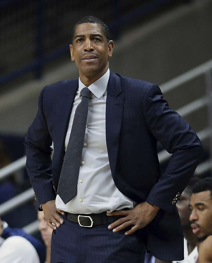 FILE - In this Feb. 7, 2018, file photo, then-Connecticut head coach Kevin Ollie watches the first half an NCAA college basketball game, in Storrs, Conn. The University of Connecticut says it fired men's basketball coach Kevin Ollie after finding NCAA violations that included improper workouts and improper contact with recruits by Ollie and former UConn star Ray Allen. In a statement to The Associated Press on Thursday, June 21, 2018, Ollie's lawyer Jacques Parenteau called the infractions cited by UConn in firing Ollie minimal and isolated. He also says they fail to justify withholding the more than $10 million they believe Ollie is owed under his contract. (AP Photo/Jessica Hill, File) Photo: Jessica Hill, Associated Press