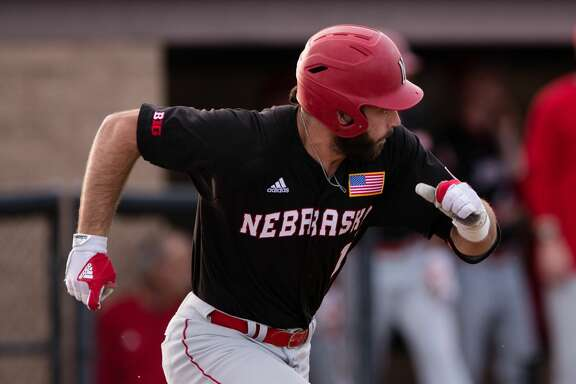 BAKERSFIELD, CA - MARCH 21: Nebraska outfielder Scott Schreiber (11) runs to first base after hitting a pitch during the game between the Nebraska Cornhuskers and the Cal State Bakersfield Roadrunners on March 21, 2017, at Hardt Field, in Bakersfield, CA. (Photo by David Dennis/Icon Sportswire via Getty Images)
