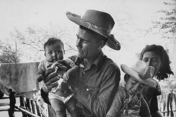 Mexican Farm Worker Angel Cos with wife & children as he prepares himself for trip to border & work in US. (Photo by Loomis Dean/The LIFE Picture Collection/Getty Images)
