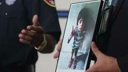 Galveston Police Detective Jeff Banks holds a photo of Jayden Alexander Lopez, the 4-year-old boy known as 'Little Jacob' after his body was found on a Galveston beach last fall. Two Houston women have been arrested and charged with crimes in connection to the investigation, Wednesday, June 20, 2018.
