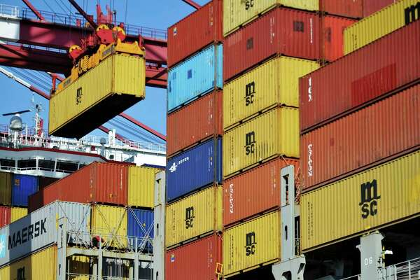 FILE - In this April 8, 2018 file photo, a container is loaded onto a cargo ship at a port in Qingdao in east China's Shandong province. China has accused the United States on Thursday, June 21, 2018, of using pressure tactics and blackmail in threatening to impose tariffs on hundreds of billions of dollars of Chinese imports. (Chinatopix via AP)