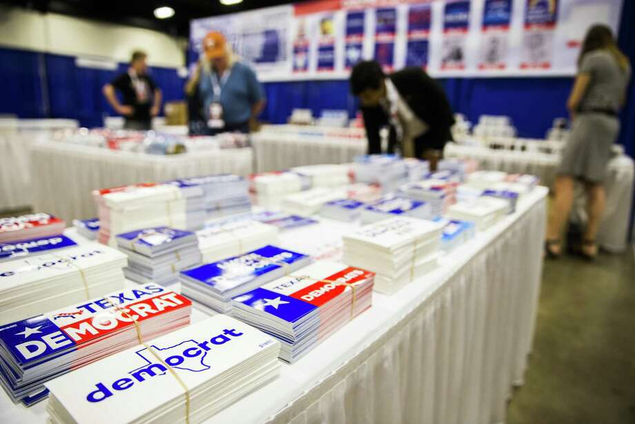 Workers set up a display of stickers, buttons and mugs as they prepare for the Texas Democratic Convention on Thursday, June 21, 2018 at the Fort Worth Convention Center in Fort Worth. (Ashley Landis/The Dallas Morning News) Photo: Ashley Landis, THE DALLAS MORNING NEWS / Staff Photographer / THE DALLAS MORNING NEWS