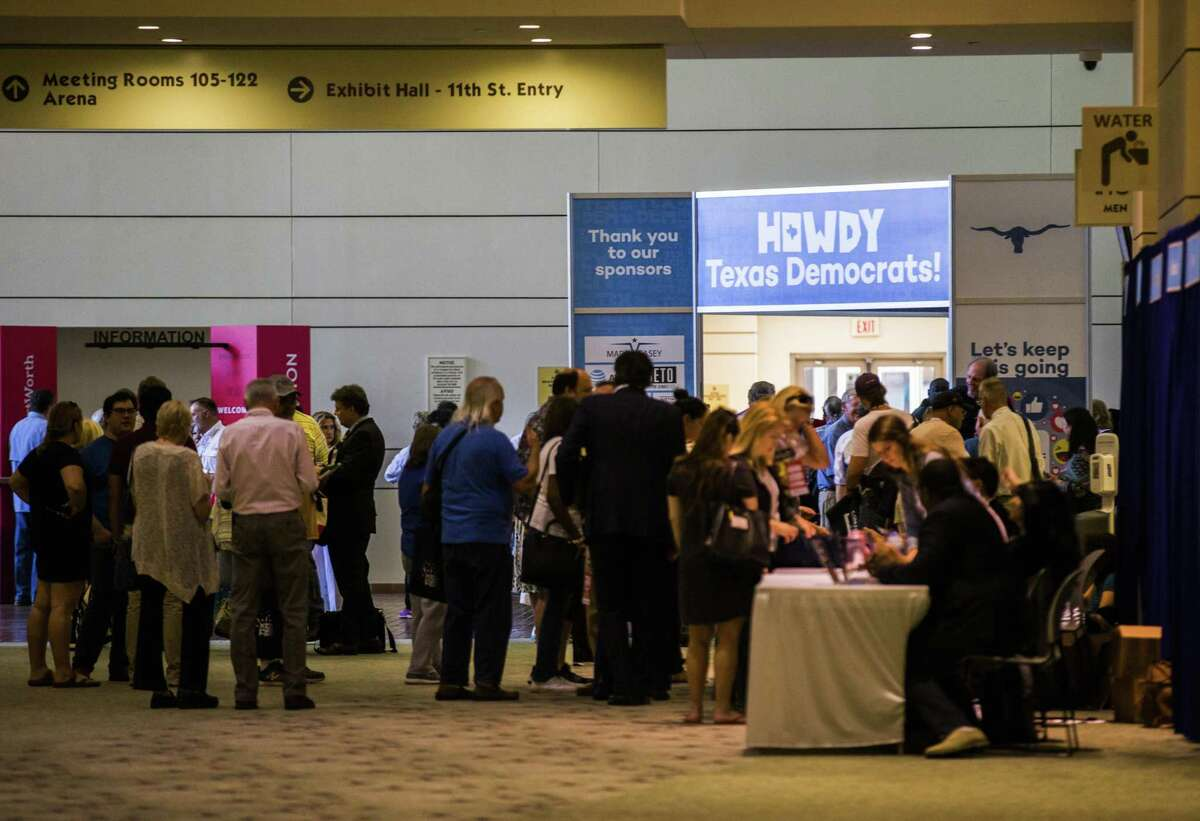 Democrats line up to register for the Texas Democratic Convention, Thursday, June 21, 2018, at the Fort Worth Convention Center in Fort Worth, Texas. (Ashley Landis/The Dallas Morning News via AP)