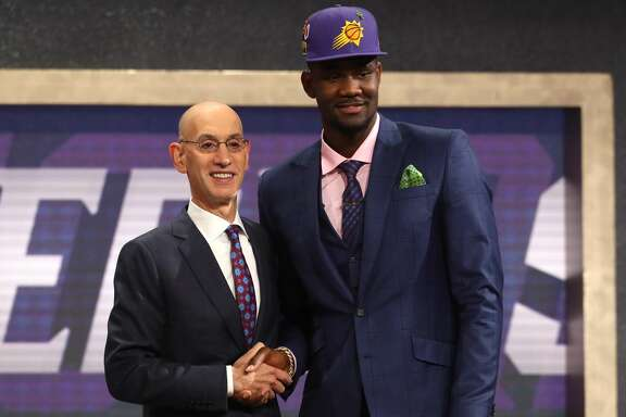 NEW YORK, NY - JUNE 21: Deandre Ayton poses with NBA Commissioner Adam Silver after being drafted first overall by the Phoenix Suns during the 2018 NBA Draft at the Barclays Center on June 21, 2018 in the Brooklyn borough of New York City. NOTE TO USER: User expressly acknowledges and agrees that, by downloading and or using this photograph, User is consenting to the terms and conditions of the Getty Images License Agreement.  (Photo by Mike Stobe/Getty Images)