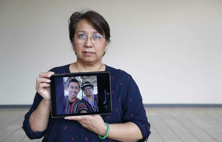 Vicky Nguyen holds a photo of her son, Will Nguyen, a native Houstonian who was among dozens of people arrested in Vietnam this week during street protests. Nguyen, was visiting Ho Chi Minh City ahead of his graduation this summer from a masters program at the University of Singapore.