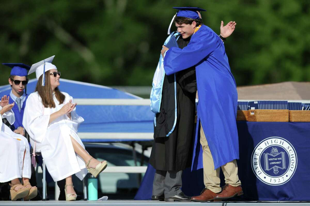 Photos from the Darien High School Class of 2018 Commencement ceremony on the school's football field in Darien, Conn. on Thursday, June 21, 2018.