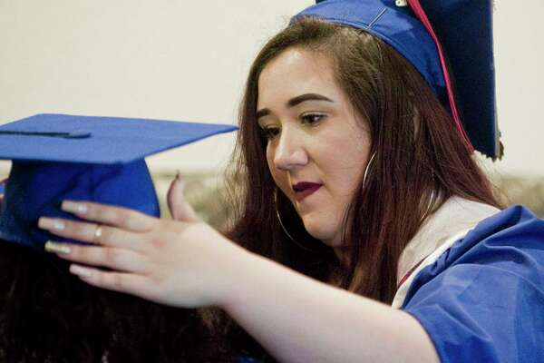 Helena Ferreira makes a hat adjustment at the ACE (Alternative Center for Excellence) graduation at West Conn's Midtown Campus Student Center. Thursday, June 21, 2018