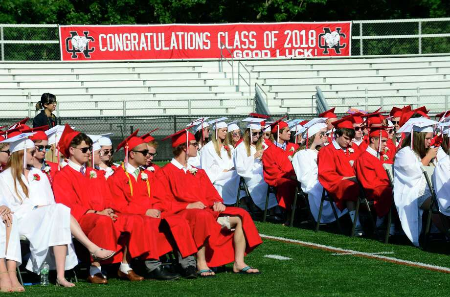 New Canaan High School holds the Class of 2018 graduation ceremony at Dunning Field on June 21, 2018 in New Canaan, Connecticut. Photo: Matthew Brown, Hearst Connecticut Media / Stamford Advocate