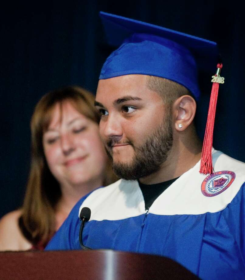 Angel Romero gives his remarks at the ACE (Alternative Center for Excellence) graduation at West Conn's Midtown Campus Student Center. Thursday, June 21, 2018 Photo: Scott Mullin, For Hearst Connecticut Media / The News-Times Freelance
