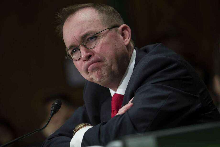 ee661de4c6a Mick Mulvaney listens during a Senate Banking committee hearing in  Washington on April 12