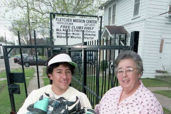 Mildred McWhorter with Juan Mendez Juan Mendez who is carrying a box of clothes from the Fletcher Mission Center.