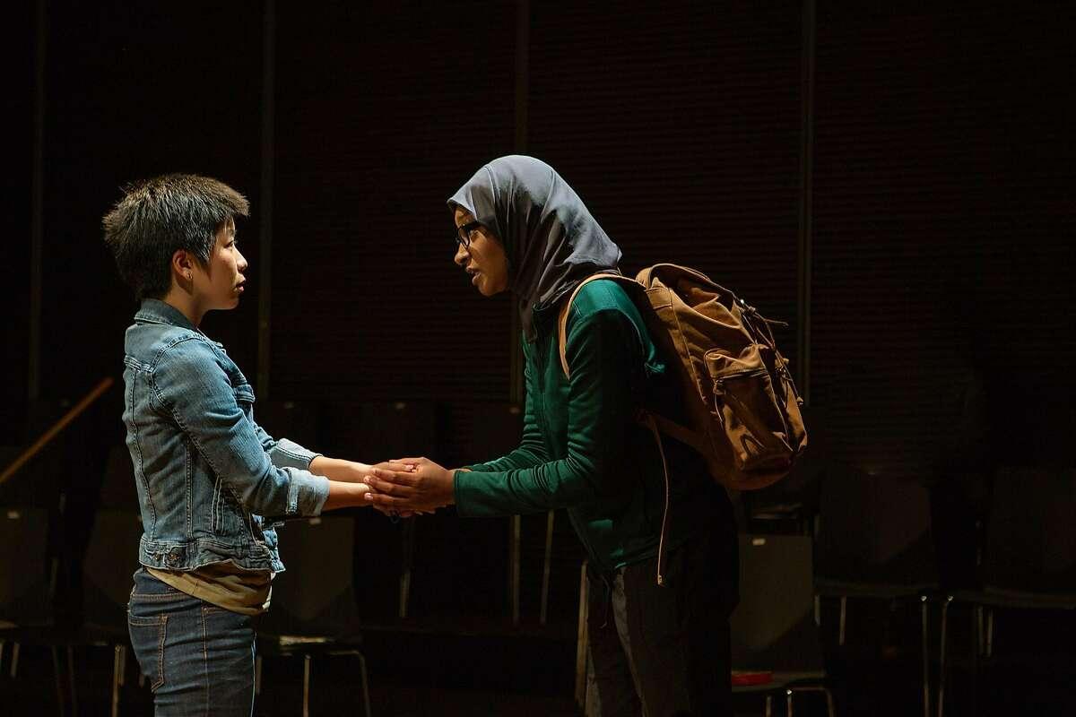 Sarah (Sango Tajima) receives a warning from Soha (Sam Jackson) in San Francisco Playhouse's