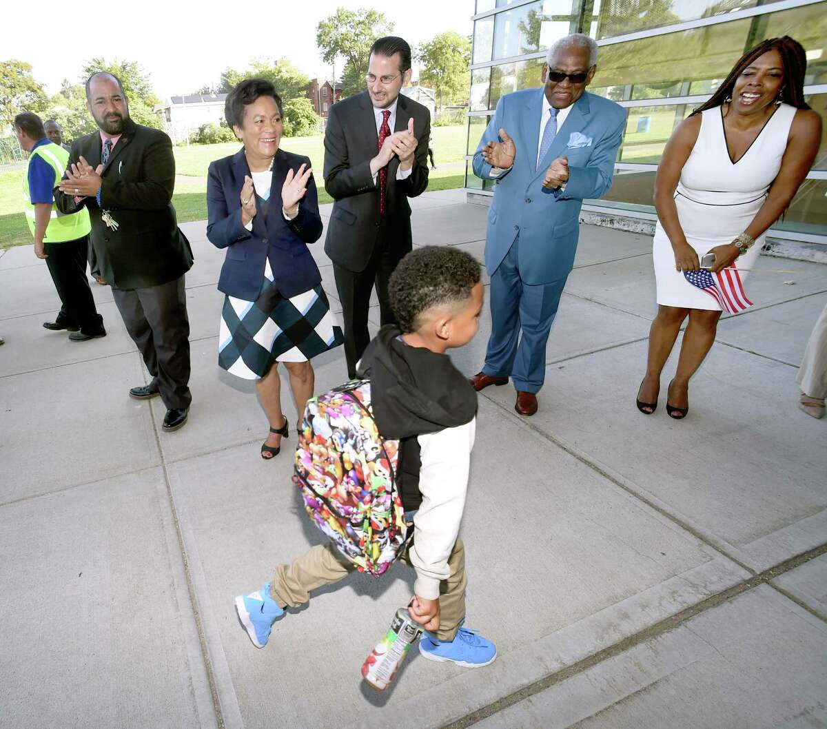 Left to right, principal Daniel Bonet, New Haven Mayor Toni Harp, state representative Al Paolillo, New Haven Superintendent of Schools Reginald Mayo and administrator Gemma Joseph Lumpkin greet students outside of John C. Daniels School of International Communications in New Haven on the first day of school on 8/28/2017. Arnold Gold / Hearst Connecticut Media
