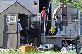 Criminal investigators with the Midland County Sheriff's Department look inside a trailer home and the area surrounding it after a body was reportedly discovered at the residence south of Midland lcoated on South County Road 115, June 21, 2018. James Durbin/Reporter-Telegram