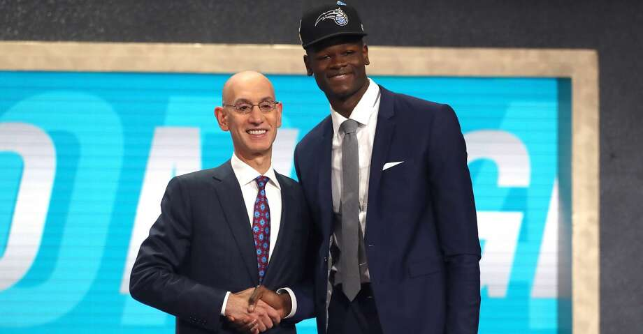 NEW YORK, NY - JUNE 21:  Mohamed Bamba poses with NBA Commissioner Adam Silver after being drafted sixth overall by the Orlando Magic during the 2018 NBA Draft at the Barclays Center on June 21, 2018 in the Brooklyn borough of New York City. NOTE TO USER: User expressly acknowledges and agrees that, by downloading and or using this photograph, User is consenting to the terms and conditions of the Getty Images License Agreement.  (Photo by Mike Stobe/Getty Images) Photo: Mike Stobe/Getty Images