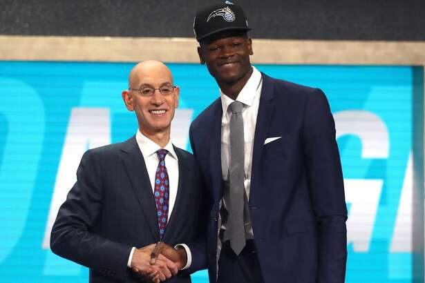 NEW YORK, NY - JUNE 21:  Mohamed Bamba poses with NBA Commissioner Adam Silver after being drafted sixth overall by the Orlando Magic during the 2018 NBA Draft at the Barclays Center on June 21, 2018 in the Brooklyn borough of New York City. NOTE TO USER: User expressly acknowledges and agrees that, by downloading and or using this photograph, User is consenting to the terms and conditions of the Getty Images License Agreement.  (Photo by Mike Stobe/Getty Images)
