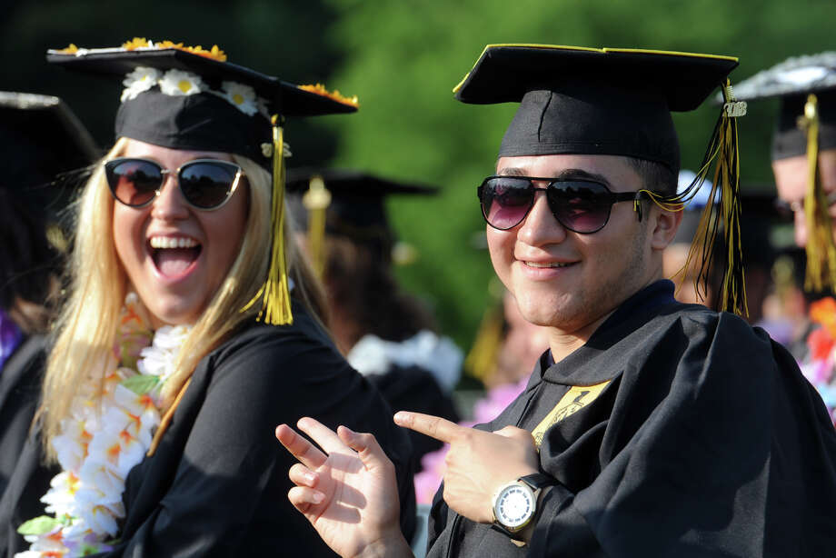 Stanley Martinez and Hannah Martins share a laugh during Commencement Exercises for the Trumbull High School graduating class of 2018, in Trumbull, Conn. June 21, 2018. Photo: Ned Gerard, Hearst Connecticut Media / Connecticut Post