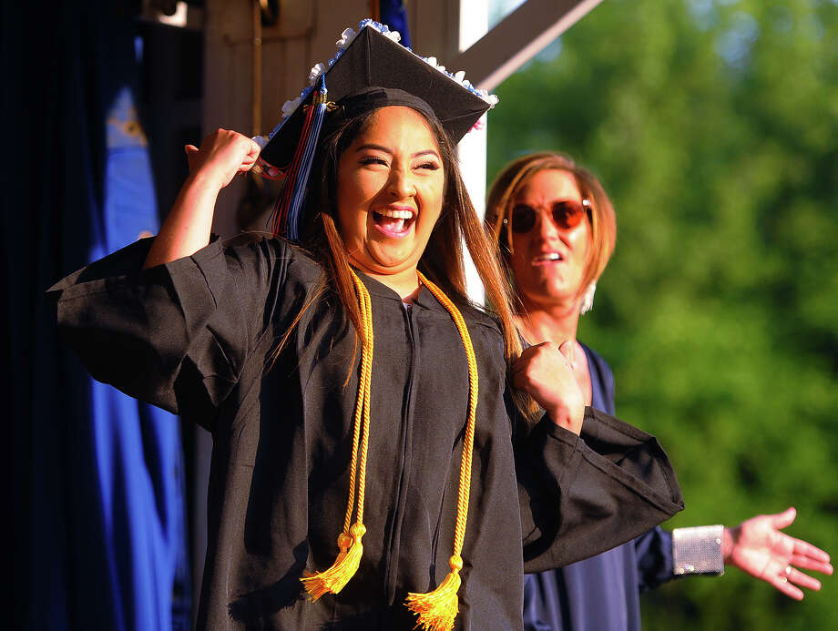 Graduate Alexia Moreno dances across the stage to receive her diploma at the Shelton High School graduation in Shelton, Conn. on Thursday, June 21, 2018. Photo: Brian A. Pounds, Hearst Connecticut Media / Connecticut Post