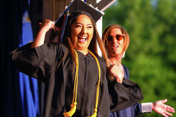 Graduate Alexia Moreno dances across the stage to receive her diploma at the Shelton High School graduation in Shelton, Conn. on Thursday, June 21, 2018.
