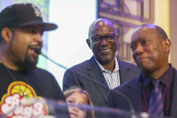 Former Rocket and BIG3 commissioner Clyde Drexler, center, joins league co-founder Ice Cube, left, and Houston mayor Sylvester Turner in celebrating the arrival of BIG3 games to the city.