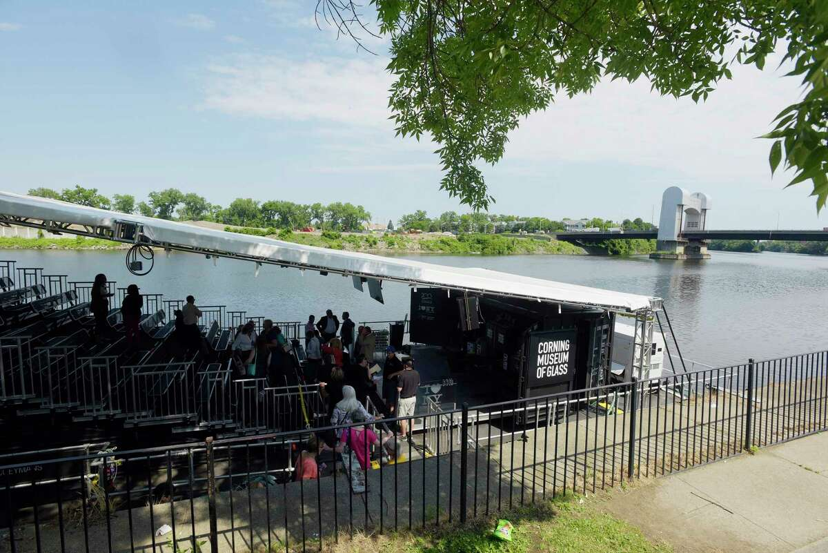 Visitors make their way onto the Corning Museum of Glass GlassBarge for a demonstration on Thursday, June 21, 2018, in Troy, N.Y. (Paul Buckowski/Times Union)