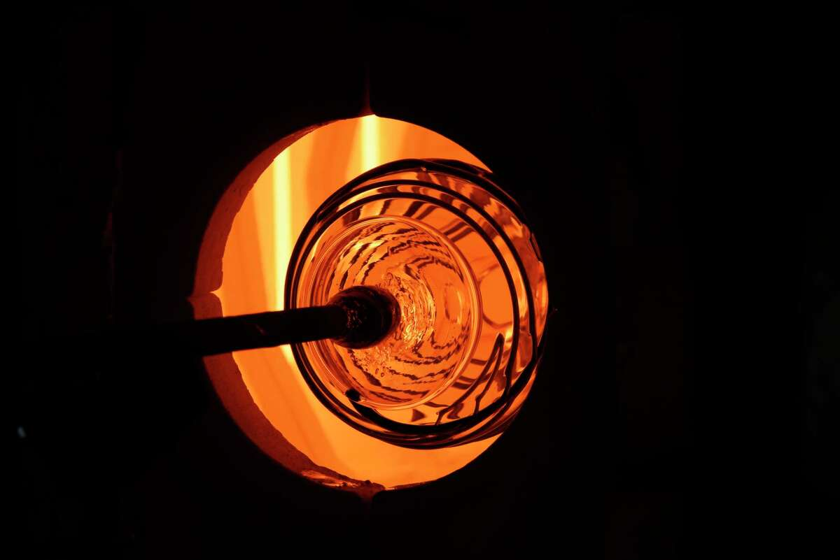 Glass is placed inside a re-heating furnace as a bowl is created by a glass blower during a demonstration on the Corning Museum of Glass GlassBarge on Thursday, June 21, 2018, in Troy, N.Y. (Paul Buckowski/Times Union)