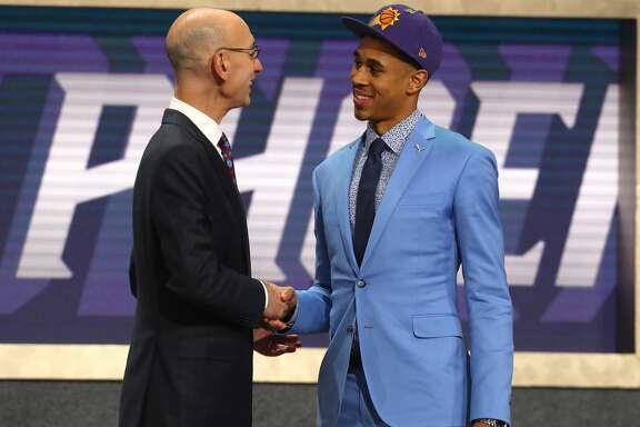 NEW YORK, NY - JUNE 21:  Zhaire Smith poses with NBA Commissioner Adam Silver after being drafted 16th overall by the Phoenix Suns during the 2018 NBA Draft at the Barclays Center on June 21, 2018 in the Brooklyn borough of New York City. NOTE TO USER: User expressly acknowledges and agrees that, by downloading and or using this photograph, User is consenting to the terms and conditions of the Getty Images License Agreement.  (Photo by Mike Stobe/Getty Images)
