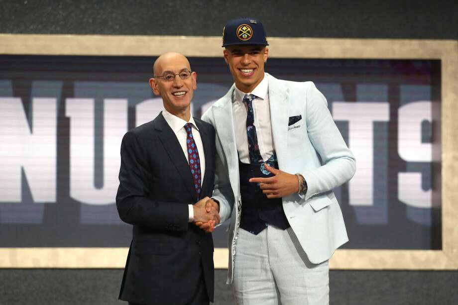 NEW YORK, NY - JUNE 21: Michael Porter Jr. poses with NBA Commissioner Adam Silver after being drafted 14th overall by the Denver Nuggets during the 2018 NBA Draft at the Barclays Center on June 21, 2018 in the Brooklyn borough of New York City. NOTE TO USER: User expressly acknowledges and agrees that, by downloading and or using this photograph, User is consenting to the terms and conditions of the Getty Images License Agreement.  (Photo by Mike Stobe/Getty Images) Photo: Mike Stobe/Getty Images
