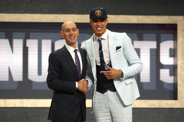 NEW YORK, NY - JUNE 21: Michael Porter Jr. poses with NBA Commissioner Adam Silver after being drafted 14th overall by the Denver Nuggets during the 2018 NBA Draft at the Barclays Center on June 21, 2018 in the Brooklyn borough of New York City. NOTE TO USER: User expressly acknowledges and agrees that, by downloading and or using this photograph, User is consenting to the terms and conditions of the Getty Images License Agreement.  (Photo by Mike Stobe/Getty Images)