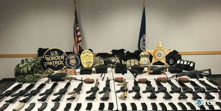 Shown are the 21 rifles and other tactical equipment federal authorities seized on Tuesday from a downtown parking lot. No arrest has been made. Photo: Courtesy Photo /Homeland Security Investigations