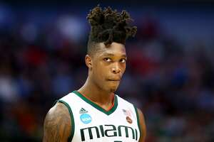 DALLAS, TX - MARCH 15:  Lonnie Walker IV #4 of the Miami Hurricanes looks on while taking on the Loyola Ramblers in the first round of the 2018 NCAA Men's Basketball Tournament at American Airlines Center on March 15, 2018 in Dallas, Texas.  (Photo by Ronald Martinez/Getty Images)