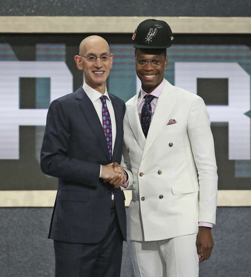 Miami's Lonnie Walker IV, right, poses with NBA Commissioner Adam Silver after he was picked 18th overall by the San Antonio Spurs during the NBA basketball draft in New York, Thursday, June 21, 2018. (AP Photo/Kevin Hagen) Photo: Kevin Hagen/AP