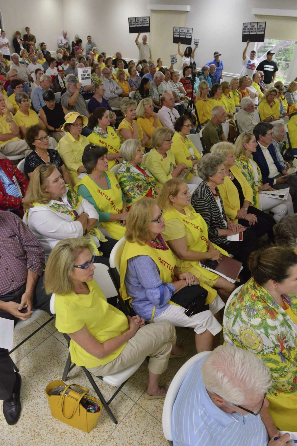 Organizers and volunteers of the Battle of Flowers parade listen to a presentation on the Alamo project Thursday evening. The group is opposed to closing Alamo Street.