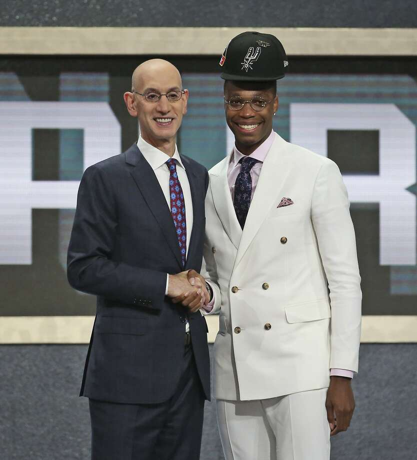 Miami's Lonnie Walker IV, right, poses with NBA Commissioner Adam Silver after he was picked 18th overall by the San Antonio Spurs during the NBA basketball draft in New York, Thursday, June 21, 2018. (AP Photo/Kevin Hagen) Photo: Kevin Hagen, Associated Press