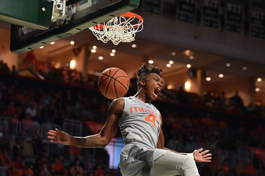 Lonnie Walker IV #4 of the Miami Hurricanes reacts after dunking the basketball during the second half of the game against the Syracuse Orange at The Watsco Center on February 17, 2018 in Miami, Florida. (Photo by Eric Espada/Getty Images) / 2018 Eric Espada