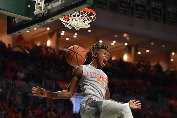Lonnie Walker IV #4 of the Miami Hurricanes reacts after dunking the basketball during the second half of the game against the Syracuse Orange at The Watsco Center on February 17, 2018 in Miami, Florida. (Photo by Eric Espada/Getty Images)