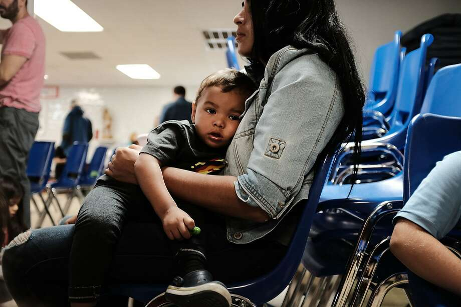 MCALLEN, TX - JUNE 21: A woman who idendtified herself as Jennifer sits with her son Jaydan at the Catholic Charities Humanitarian Respite Center after recently crossing the U.S., Mexico border on June 21, 2018 in McAllen, Texas. Once families and individuals are released from Customs and Border Protection to continue their legal process, they are brought to the center to rest, clean up, enjoy a meal and get guidance to their next destination. Before Trump signed an executive order yesterday that the administration says halts the practice of separating families seeking asylum, more than 2,300 immigrant children had been separated from their parents in the  zero-tolerance policy for border crossers. (Photo by Spencer Platt/Getty Images) Photo: Spencer Platt, Getty Images