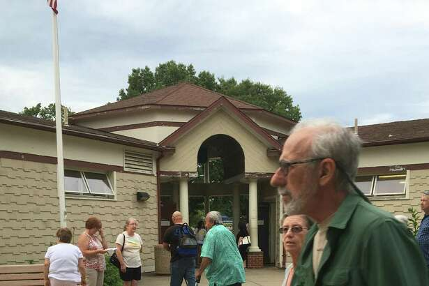 West Haven residents meet Wednesday night at the bathrooms at Old Grove Park along the shorefront walkway at Savin Rock to discuss the fact that the bathrooms are currently are closed on weekends, and other city maintenance issues.