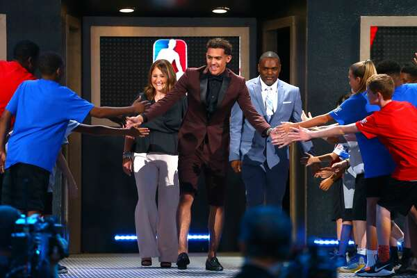 NEW YORK, NY - JUNE 21:  Trae Young is introduced before the 2018 NBA Draft at the Barclays Center on June 21, 2018 in the Brooklyn borough of New York City. NOTE TO USER: User expressly acknowledges and agrees that, by downloading and or using this photograph, User is consenting to the terms and conditions of the Getty Images License Agreement.  (Photo by Mike Stobe/Getty Images)