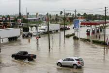 Flooding is seen Thursday at the intersection of South 23rd Street and FM 1016 in Hildago. Texas 115 was closed between Hildago and McAllen causing the traffic to pile up on FM 1016.