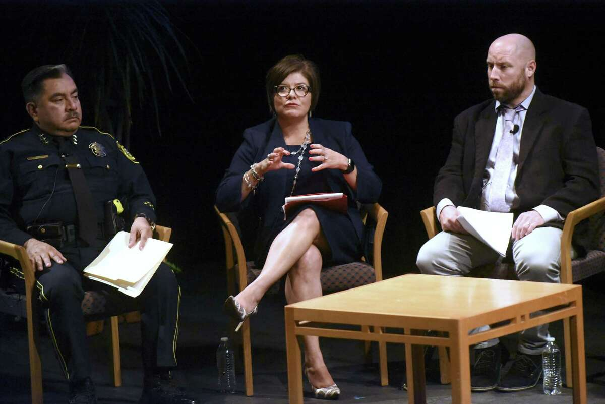 Deputy Don Tijerina (left); Lori Valenzuela, judge of the 437th District Court; and Dr. Richard Hartley, professor of criminal justice at UTSA, participate in a criminal justice town hall meeting at the University of Texas at San Antonio downtown campus.