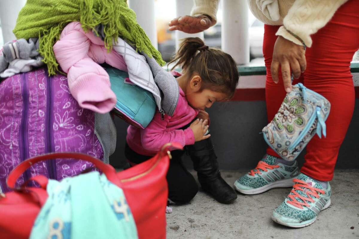 TIJUANA, MEXICO - JUNE 21: A migrant mother waits with one of her two daughters on their way to the port of entry to ask for asylum in the U.S. on June 21, 2018 in Tijuana, Mexico. The mother, who did not wish to give their names, said they were fleeing their hometown near the Pacific coast of Mexico after suffering a violent carjacking of her taxicab. The Trump Administration's controversial zero tolerance immigration policy led to an increase in the number of migrant children who have been separated from their families at the southern U.S. border. U.S. Attorney General Jeff Sessions has added that domestic and gang violence in immigrants' country of origin would no longer qualify them for political asylum status. (Photo by Mario Tama/Getty Images)